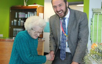 Cake and haircut for 100th birthday celebration